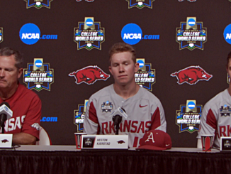 Arkansas coach and players
