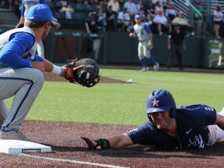 Vanderbilt baseball player slides to base