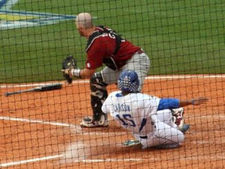 Kentucky baseball players slides to home plate