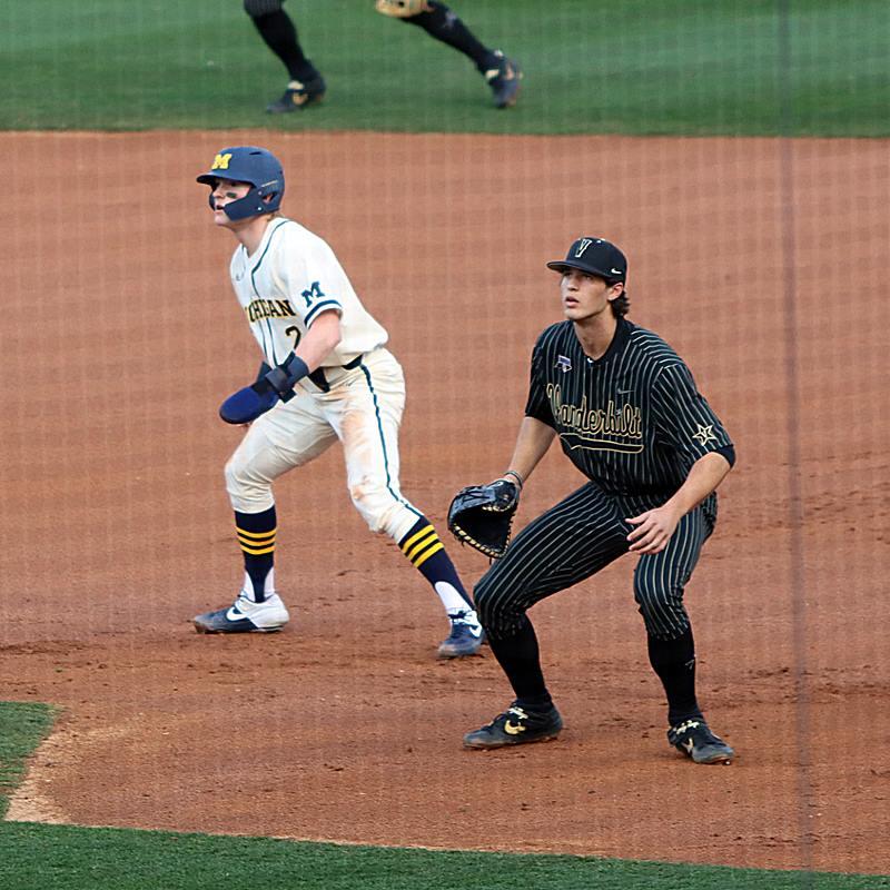 Jack Blomgren of Michigan (L) and Spencer Jones of Vanderbilt (R)
