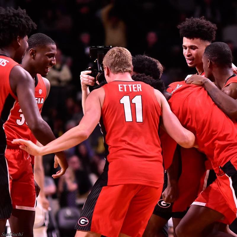 Georgia basketball players celebrate