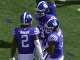 Kentucky football players celebrate score