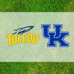 Kentucky-Toledo logos on grass