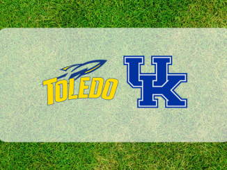 Kentucky-Toledo logos on grass