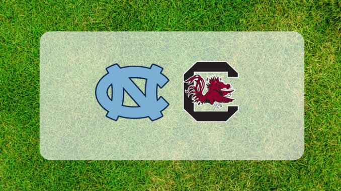 South Carolina North Carolina logos on field of grass