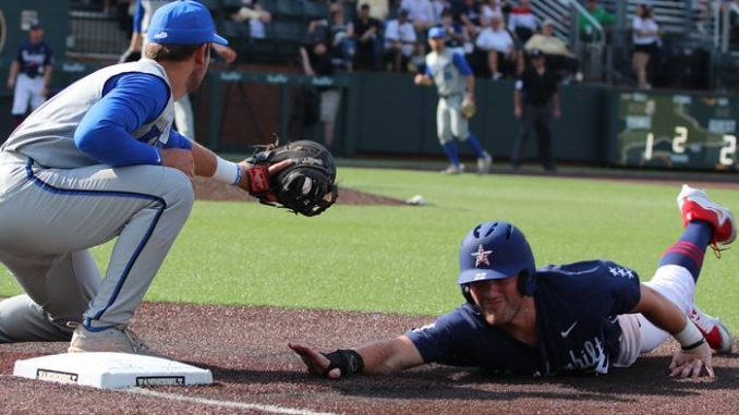 Vanderbilt baseball player slides to base