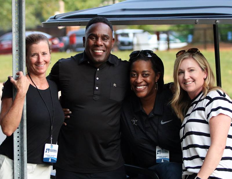 Derek Mason and three women