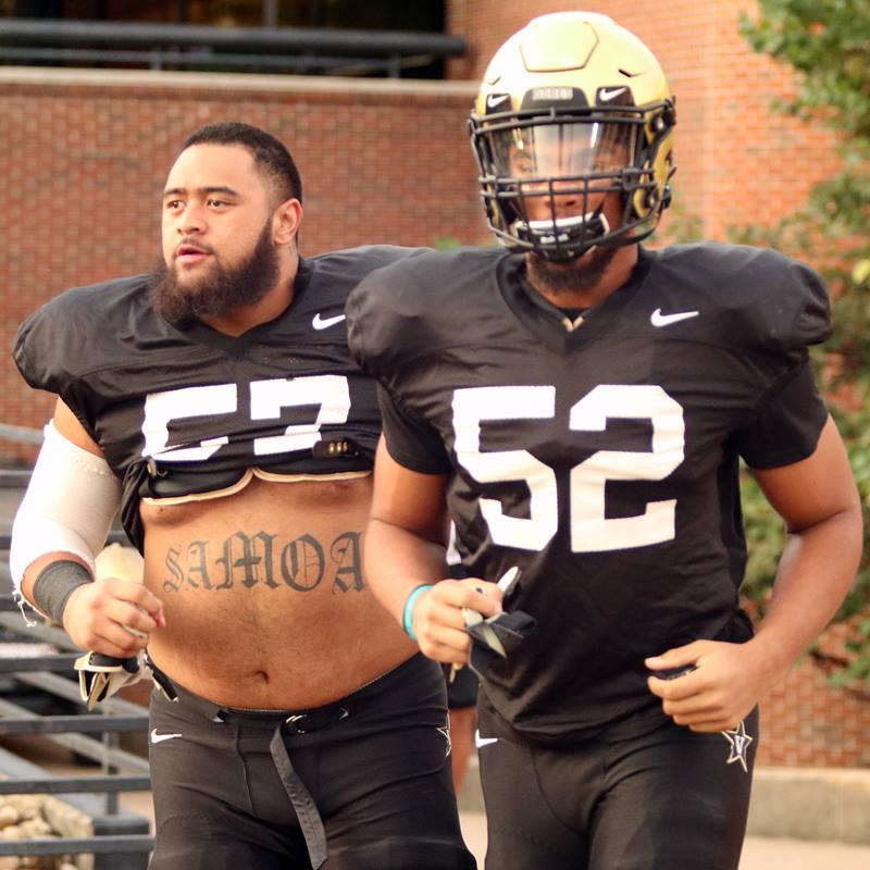 DL Josiah Sa'o (57) and LB Alex Brown (52)
