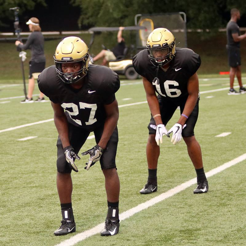 FR DB Tre Sands (27) and CB BJ Anderson (16)