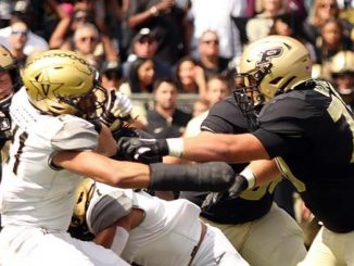 Vanderbilt and Purdue football players
